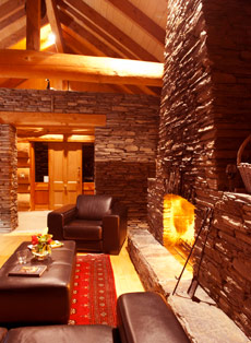 The lounge has a large stone fireplace